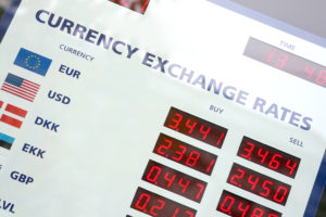 Handling exchange rates when completing business deals